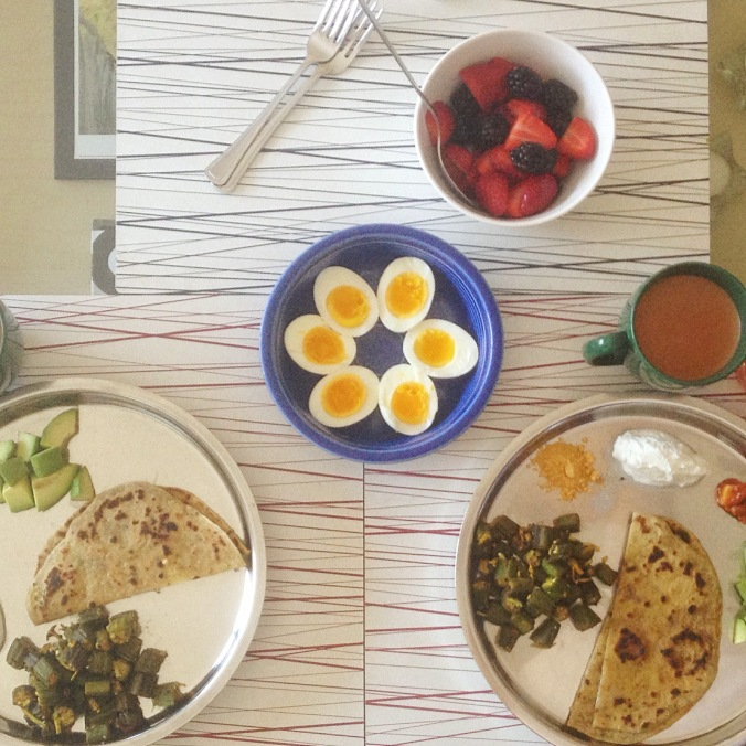 Eggs alongside an Indian breakfast of okra and paratha (whole-wheat flatbread).