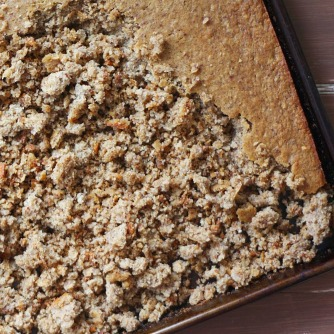 Crumbling cake into cereal pieces.