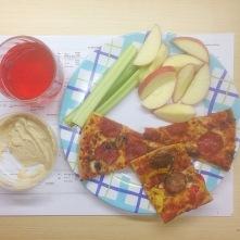 Pizza, fruit/veg, hummus, kombucha.